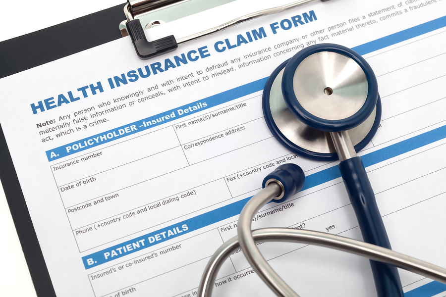 Medical and health insurance claim form with stethoscope on clipboard